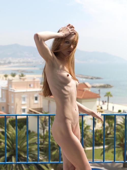 Nude ginger posing outside