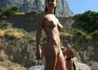 Naked girl on top of the mountain