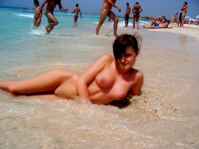 Stunning brunette posing nude on the beach