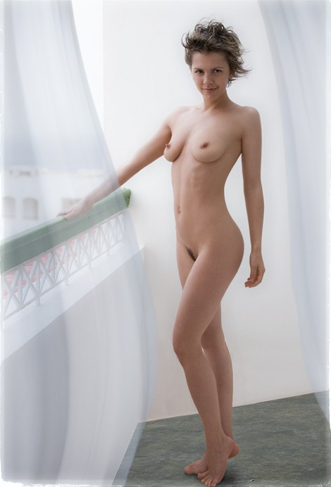 Skinny brunette poses for the camera