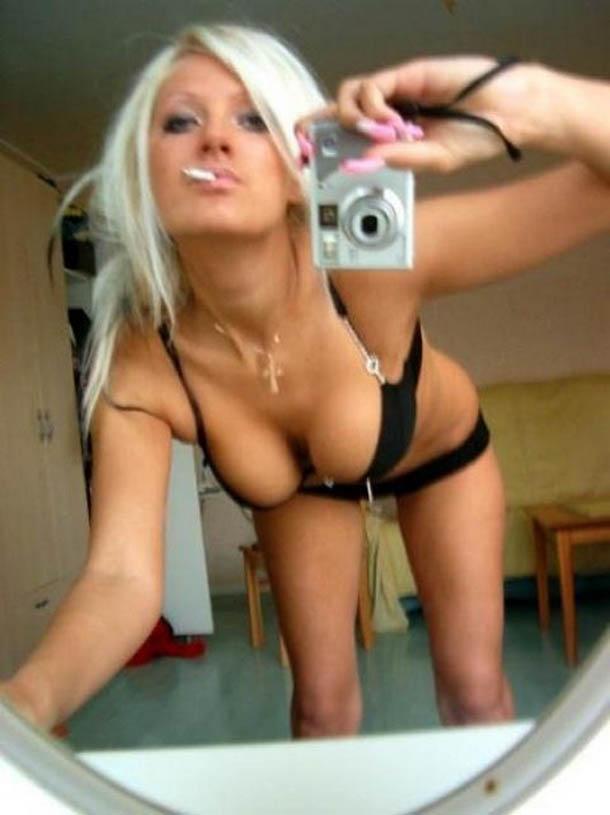 Blonde takes a selfshot in black bikini