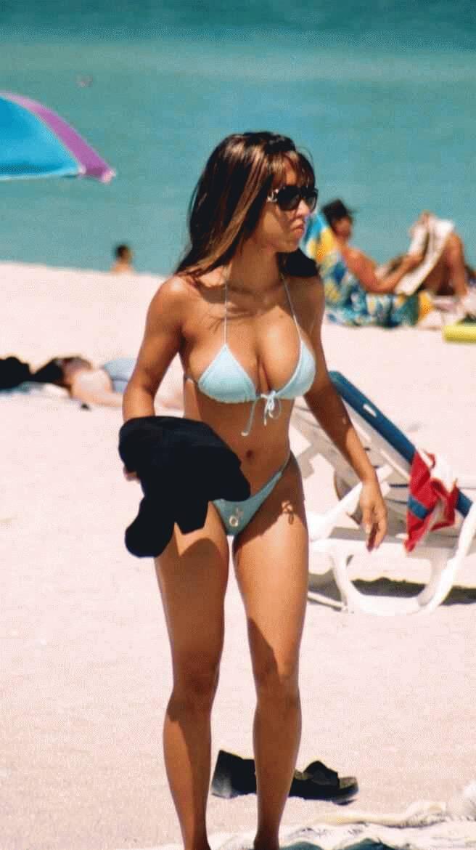 Hot babe caught wearing sexy bikinis