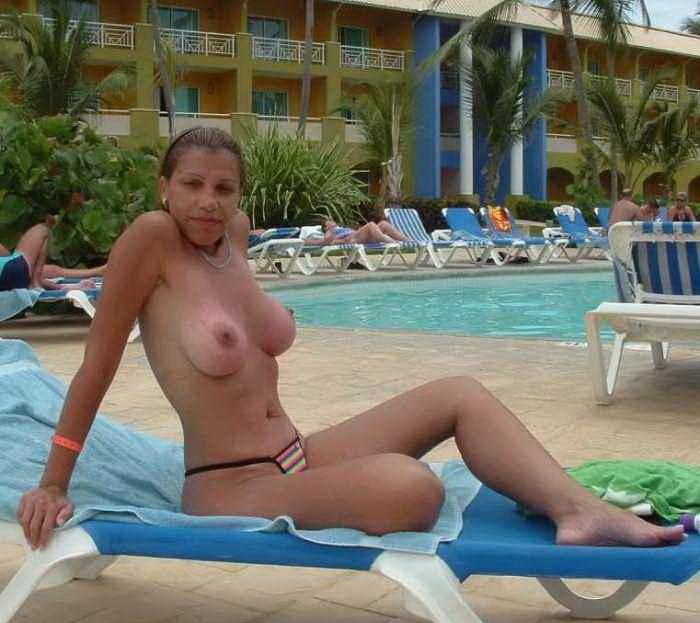 Busty hottie tanning her pert boobies