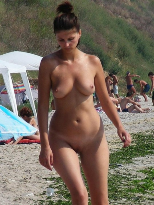 Gorgeous nude wife walking on the beach