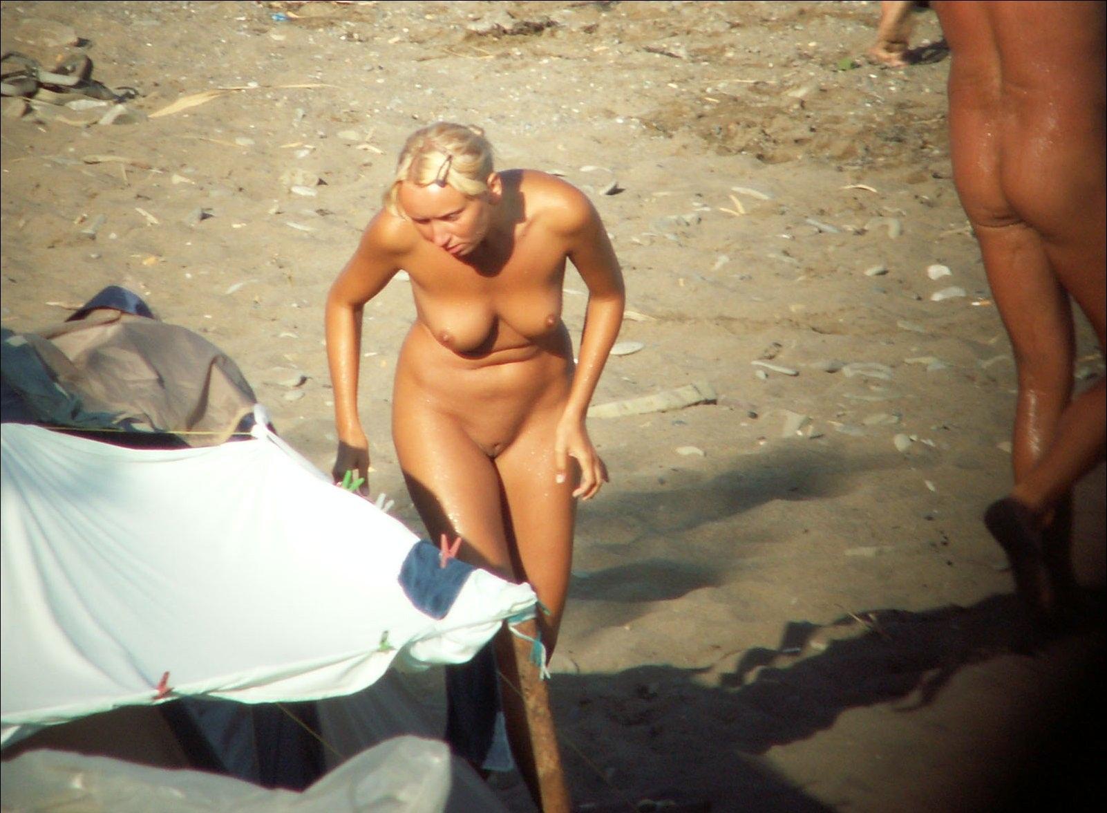 Nude girl exposed by voyeurs walking on the beach