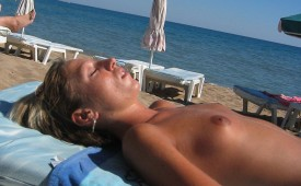 305-Tanning-blond-beauty-exposed-topless.jpg