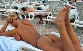 315-Tanning-her-nice-butt.jpg