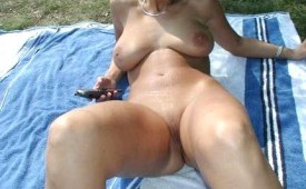 316-Thick-big-breasted-hottie-spreading-her-legs-outside.jpg