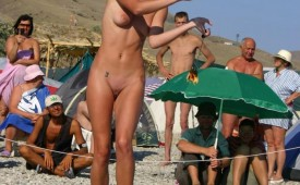 326-Tanned-woman-shows-off-shaved-pussy-for-crowd.jpg