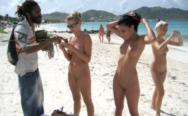 387-Hot-babes-on-an-exotic-beach-picking-some-souvenirs.jpg