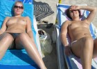 Topless beauties tanning their young bodies