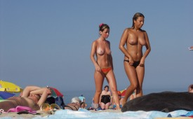470-Topless-cuties-walking-on-the-beach.jpg