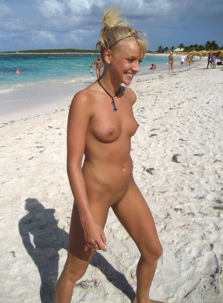 Sweet happy girl caught nude walking on beach