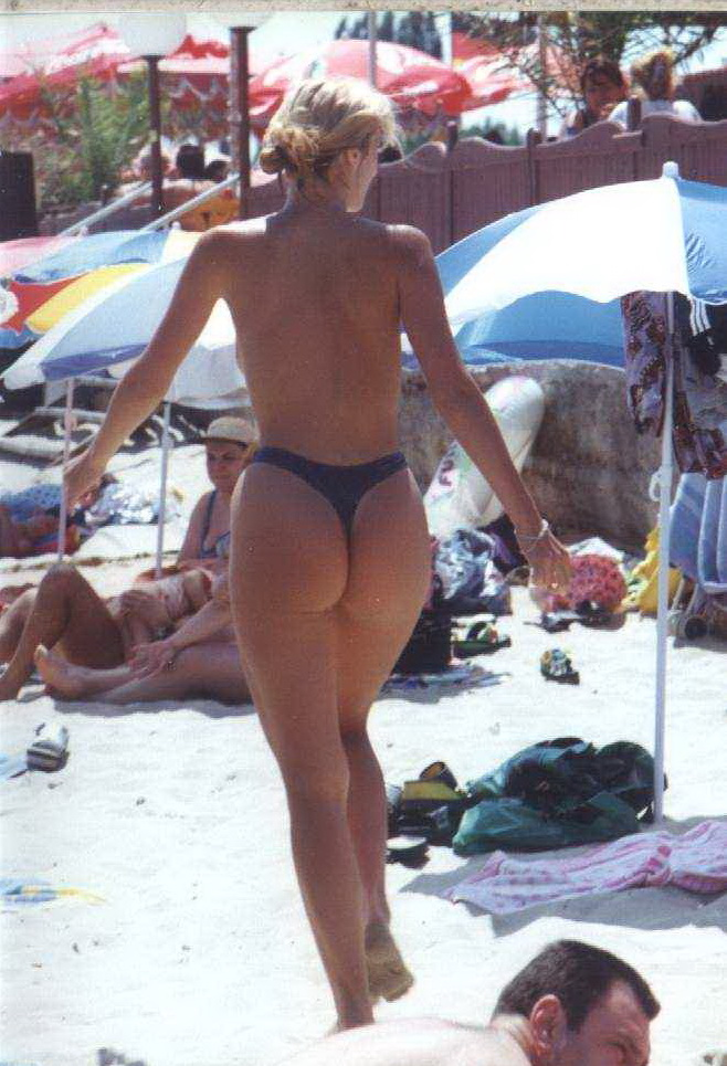 Walking on the warm sands exposing her round ass
