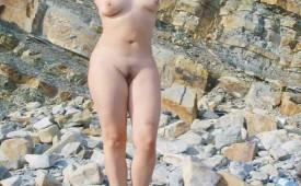 571-Voluptuous-nude-girlfriend-shows-her-body-on-a-rocky-beach.jpg