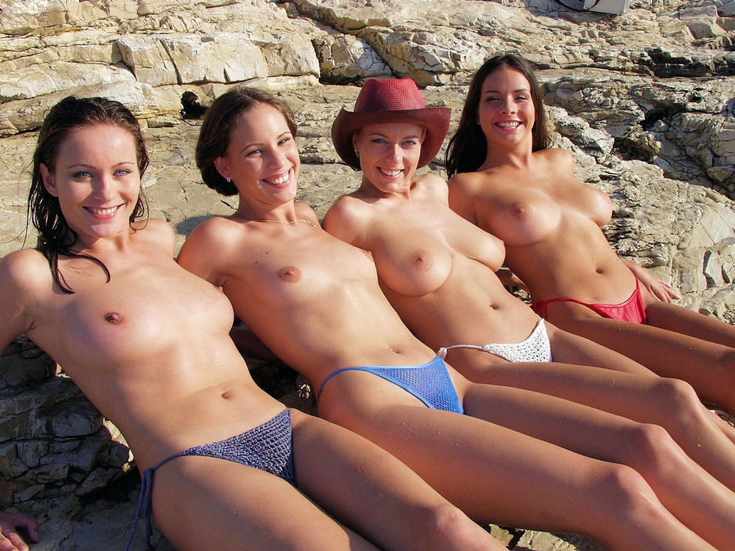 Happy topless girls exposing their boobs
