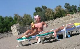 632-Hot-blonde-babe-rubbing-suntan-lotion-on-her-sexy-friend.jpg