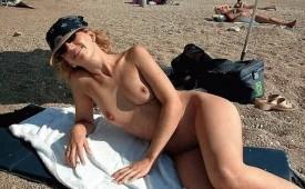 639-Hot-naked-chick-looking-fancy-on-an-empty-beach.jpg