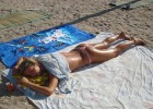 Hot bikini babe tanning her gorgeous body
