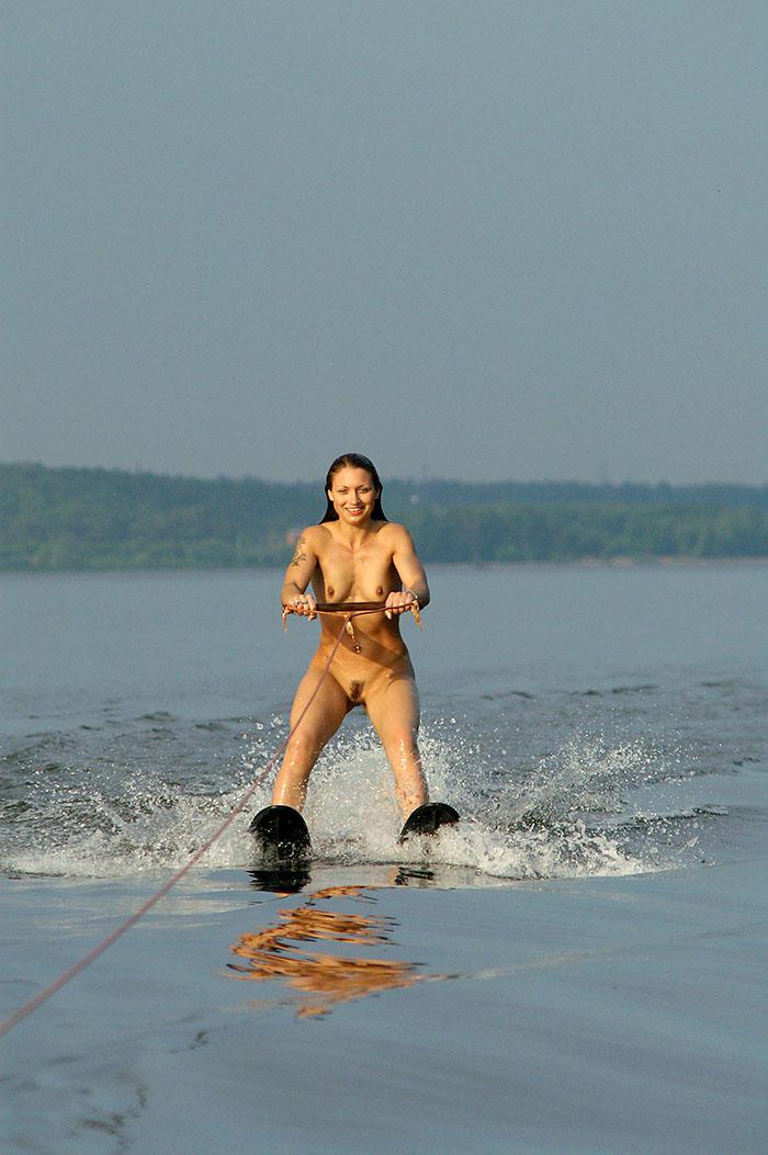Nude beautiful babe skying on water