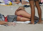 Sexy chick exposing her appetizing butt on beach