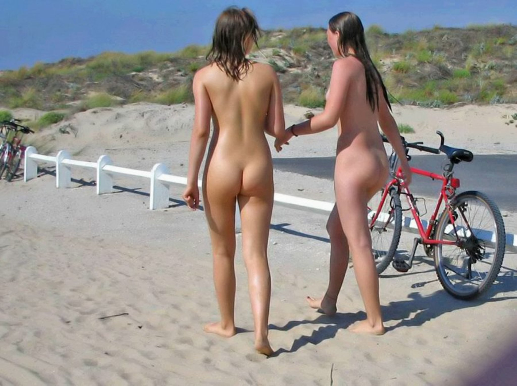 Nudist teens after a cooling swim in ocean
