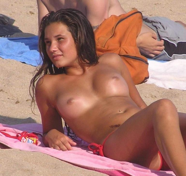 This gorgeous chick is getting her cute titties tanned