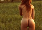 Readhead shows her amazing ass outside