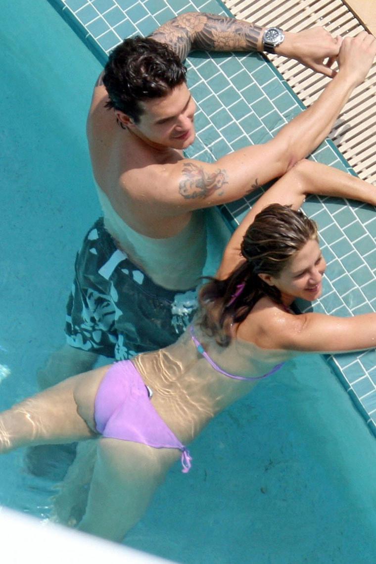 Amateur couple having fun at pool
