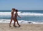 Hot chicks walking on the beach