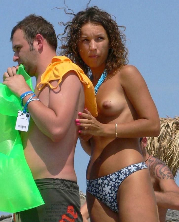 Shy girlfriend exposing her boobies