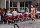 Nude woman walking in street