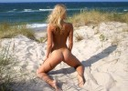 Hot blonde with a sexy body enjoying the breeze on her skin