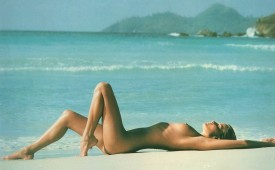 816-Nudist-beauty-laying-naked-on-the-warm-sands.jpg